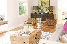 Rustic wood, mid century modern, symmetry, and abstract colorful art make for a fun eclectic mix.