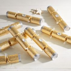 Pull the ends of our party crackers and they'll pop open with a bang, showering jokes and fun party favors.<br><BR>Each cracker contains a paper hat, a joke and wine charm.
