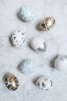 Using painters tape, yarn, or doilies, cover each egg. Spray each with desired paint and allow to dry!