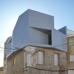 Spanish firm Grupo Aranea have designed this apartment to sit on the roof of a house belonging to the client's mother.