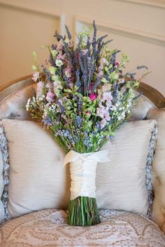 wildflower bouquet with lavender resting against chair @myweddingdotcom