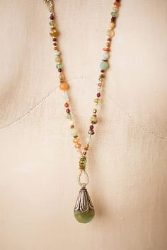 Vibrant gemstones form a longer drop necklace in a refreshing color palette! Semi-precious stones include chrysophase, amazonite, moonstone, handmade Czech glass and much much more. Extra length allo