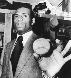 Roberto Clemente holding his 3,000-hit ball