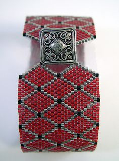 Lattice Cuff by ARoseByName, via Flickr- Brick stitch with Delica beads.