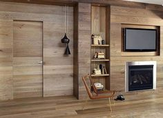 Home Design and Decor , Home Interior Wall Cladding Ideas : Wood Interior Wall Cladding Ideas With Built In Shelves And Fireplace And Lcd