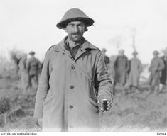 Just out from the Battle of Passchendaele Ridge, an unidentified member of the 10th Australian Infantry Brigade prepares to have a shave during a brief rest period at Dragoon Farm, near Ypres. 14 October, 1917.