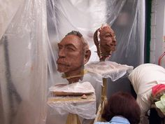 Clay portraits waiting to be cast