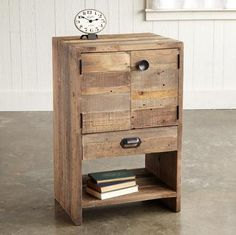 """TIOGA PASS SIDE TABLE--Wood boards salvaged from rugged shipping pallets are repurposed by sleek design into a rustic patchwork at home in urban loft or country cottage. FSC-Certified reclaimed wood in earthy naturals, forged iron hardware. One drawer and one shelf behind doors. Imported. Ships from our supplier in 2 to 4 weeks. Additional shipping, $40. 20""""W x 16""""D x 32""""H."""