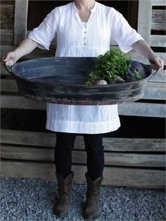 Our Decorative Oval Metal Tray has handles and a distressed black finish. It is large so would be perfect as the focal for your table centerpiece or to hold all the goodies at your next barbeque or ou