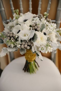 White and grey bouquet with gold wrap...pretty! The grey balls can be khaki instead.
