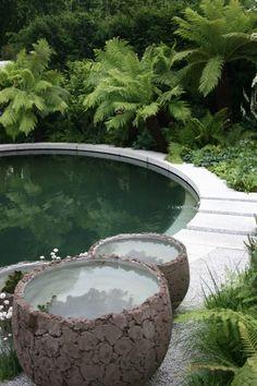 chelsea flower show  I love those big water pots.