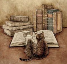 the perfect combination: kitties and books <3 now, all we need is some tea.