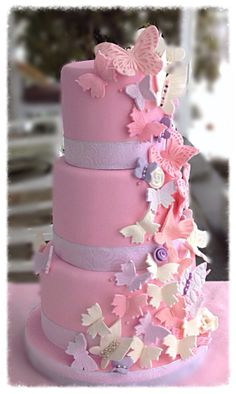 Cascading+Butterflies++-+Coconut+cake+with+raspberry+filling+for+100+guests+-+cascading+butterflies+in+pinks+,+purples,+whites+&+pearls.+...+There+is+a+hint+of+shimmer+on+the+entire+cake+:-)