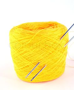 bobbin-of-yellow-thread-with-knitting-needle.jpg
