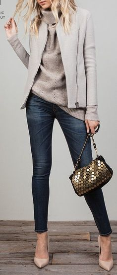 Blue jeans,  neutral sweater + jacket, gold bag.