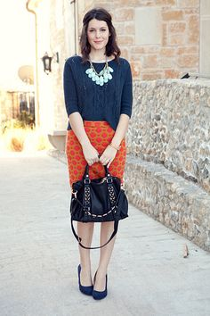 Chunky sweater, patterned skirt, and chunky necklace