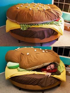 Man sleeping in a unqiue hamburger bed