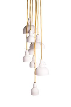 Lolo lights.  white porcelain pendant with yellow gold fabric cord