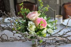 Simple centerpieces or accent flowers for sign in table