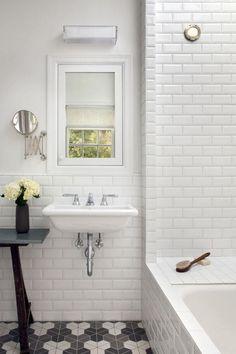 clean, simple white tile + light-and-dark floor Porthole windows for more light in the shower?