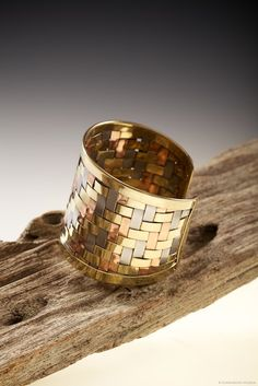 Our Woven Brass & Copper Cuff Bracelet is handmade by artisans in Northern India using the highest quality of brass, copper, and steel.