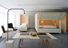 Wooden boxes on wheels fold open to reveal beds inside this minimal apartment in Bolzano, Italy, by Harry Thaler Studio (+ slideshow).