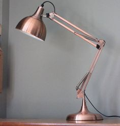A fantastic copper angled table lamp. This adjustable table lamp comes in a really vibrant copper coloured metal and is great to have on your desk or bedside table as a reading light. It has a good, sturdy construction and is adjustable. It will add a funky and contemporary feel to any room. It would also make a great wedding present.Copper40 x 15 cm x 20 cm