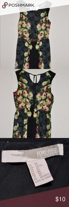 Floral Black Dress Worn once! Floral print on a solid black dress. Ties in the back along with a working zipper. Comes just above the knee making it a perfect dress for business wear! Forever 21 Dresses Asymmetrical
