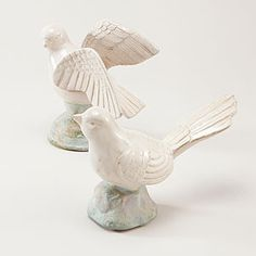 World Market White Ceramic Birds. The one with its wings closed would be lovely on my book shelves.