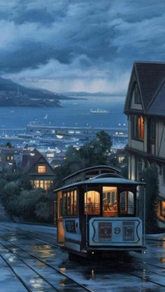 "A tram line, artistically prtrayed running through San Francisco, California, United States. ""The scene is just so picturesque, I wish I could have seen it for myself. The warm yellow contrasts well with the blue of the evening sky, and yet complements it, making the rain look almost inviting."""