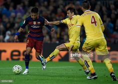 Barcelona's Brazilian forward Neymar vies with Sporting Gijon's defender Luis Hernandez during the Spanish league football match FC Barcelona vs Real...