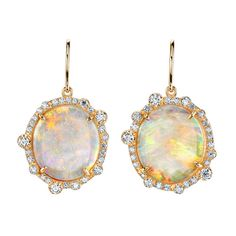 Beautiful opals are set in rose gold surrounded by round brilliant diamonds. The opals weigh 7.45cts total.
