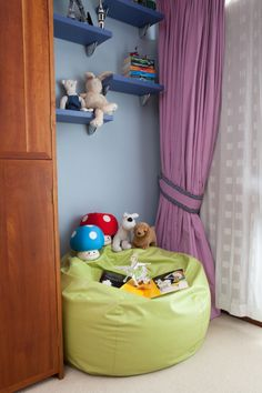 This #reading corner in the newly designed bedroom for a brother/sister sharing - worked well used different #blue colours and #dark blue shelves to blend in with the #bedside wall perfect for  #displaying #lego and #toys