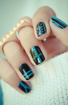 Fun Black and Blue striped and dotted nails! #nailart #blue #black #striped #dotted #nails Get more pretty nail looks at http://bellashoot.com #cutenails