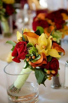 Brides maid bouquets with less of the yellow hue and more of the orange and cranberry and deep purple.