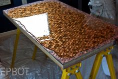 EPBOT: Money Money Money   Instructions for covering a desk with pennies.  Pretty!!