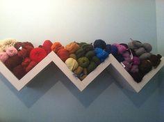 Zig zag shelving for yarn storage   (ikea LACK shelves, via Ravelry)