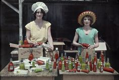 Autochrome: Edwin L. Wisherd. Two women sell pepper sauce and pickled peppers. Saint Martinville, Louisiana, USA.