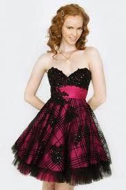 short blac dress with pink belt and skirt