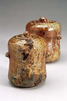 Hand built woodfired ceramic pottery jugs ash and salt glazed