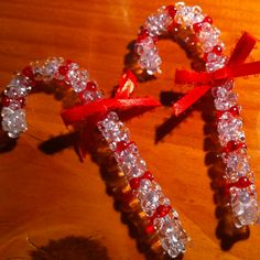 Candy canes.  Materials needed: pipe cleaner. Beads. Ribbon. Hot glue gun. So simple and easy to make!