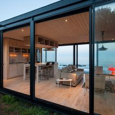 This modern remote seafront cottage is situated in Pichicuy, Chile.....by Felipe Assadi ....