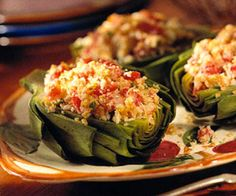 Artichokes Parmesan -these tomato-and-Parmesan crumb-topped artichokes are elegant enough to serve with your fanciest meals.