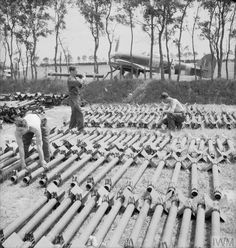Armourers of No. 121 Wing fit fins to rocket projectile bodies at Fresne Camilly, Normandy. Hawker Typhoon Mark IB, 'HH-R', of No. 175 Squadron RAF stands parked behind the trees. Ww2 Aircraft, Fighter Aircraft, Military Aircraft, Westland Whirlwind, Hawker Typhoon, The Spitfires, Royal Air Force, D Day, Wwii