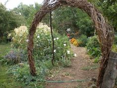 diy garden archway | love that Leslie's garden entrance is welcoming with an arch that ...