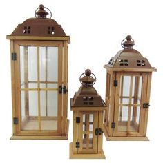 Set of three wood and metal lanterns with light brown finishes.  Product: Small, medium and large lanternConstruction Material: Wood and metalColor: Light brownDimensions: Small:  15 H x 12 W x 12 DMedium: 22 H x 12 W x 12 DLarge: 27 H x 12 W x 12 D