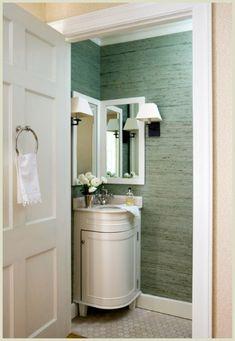Corner sink, grasscloth, & towel ring on the door ---- love the double mirrors