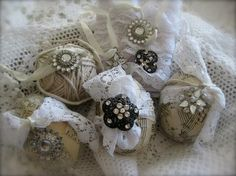 Lovely decorated eggs with lace and vintage buttons