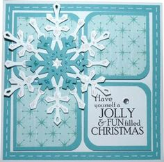 handmade Christmas card ... blues ... gorgeous layered die cut snowflake ... rounded corner squares ... patterned paper ... faux stitching ...