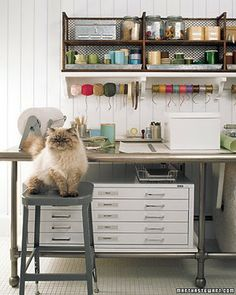 love the entire thing! the large table and the way it's constructed with piping and space underneath, the flat file and the wall shelving and space for ribbons!